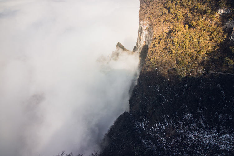 High angle view of mountain during foggy weather