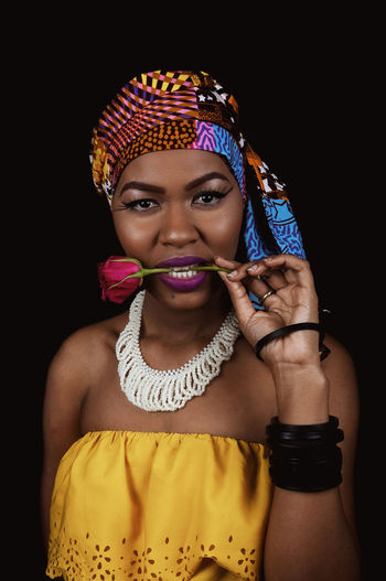 Black Woman African Woman  Headwrap  Happy African Fabric Portrait Makeup Eyes Lips Lipstick Eyelash Eyeliner African Accessories Smiling Teeth Pearl Jewelry Fashion Studio Shot Black Background One Person Indoors  Front View Young Adult Women Young Women Lifestyles Beautiful Woman Looking At Camera Standing Adult Waist Up Real People Headshot Hairstyle