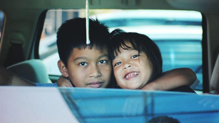 Portrait of siblings in car