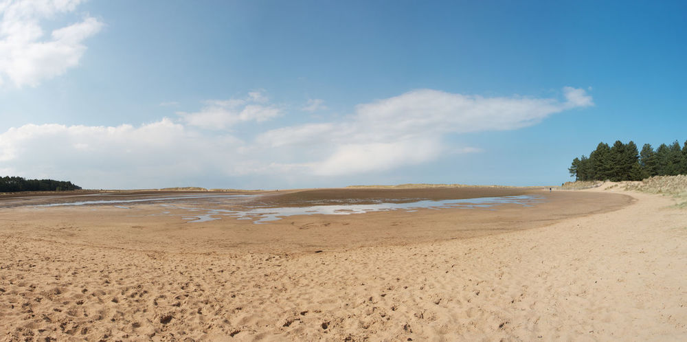 A panorama of Holkham Bay, Norfolk, England Beach Beauty In Nature Cloud - Sky Day Holkham Beach Landscape Nature No People Norfolk Outdoors Panorama Sand Scenics Sea Sky Tranquil Scene Tranquility Tree Water