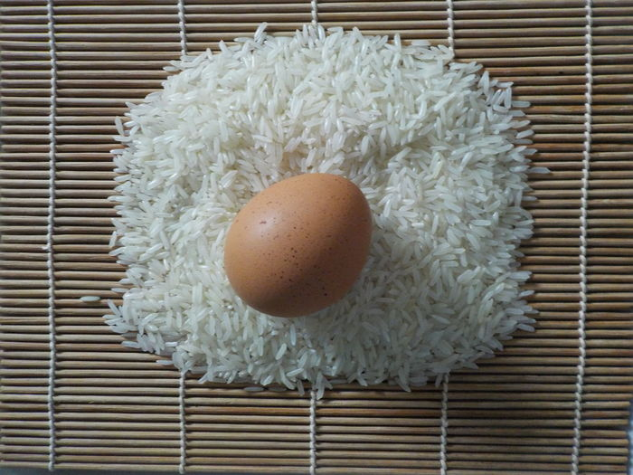 fresh egg and rice grains Food Food And Drink Egg Wellbeing Directly Above Healthy Eating Indoors  Freshness No People Still Life Close-up High Angle View White Color Table Raw Food Meal Egg Yolk Pattern Healthy Lifestyle Animal Egg Rice Paddy Rice Grain Egg And Soldiers
