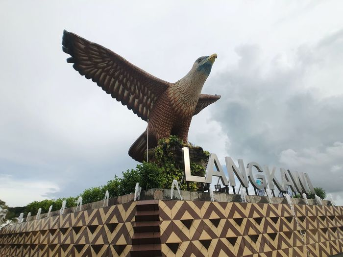 Landmark of LANGKAWI, KEDAH Malaysia Tourism Holiday Boat Ferry Jetty Airport Blue Sea Square Langkawi Square Place Logo Signage State Art And Craft Animal No People Vertebrate Animal Representation Building Exterior Representation Flying Bird Sculpture Spread Wings Animal Themes Creativity