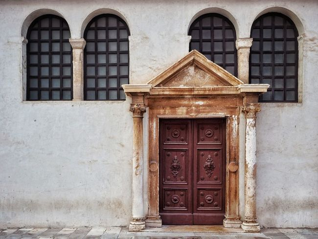 Side door to a church Travel Minimalobsession Built Structure Architecture Minimalism Street Wood Wooden Door Textured  Architectural Feature Entrance Windows Four Symmetry Symmetrical