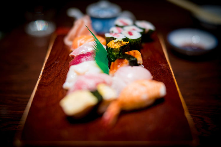 Sushi Asian Food Close-up Crockery Dinner Food Food And Drink Freshness Garnish Healthy Eating Indoors  Japanese Food No People Plate Ready-to-eat Rice Sashimi  Seafood Selective Focus Still Life Sushi Table Temptation Tray Wellbeing Wood - Material