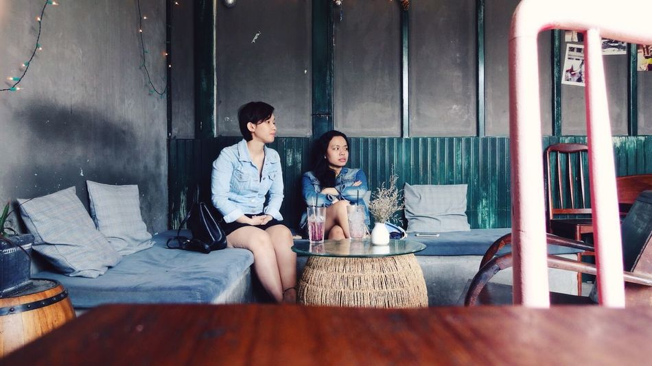 ASIA Building Cafe Casual Clothing City Coffee Depth Of Field Friendship Ho Chi Minh City Indoors  Lifestyles NOMAD People Portrait Real People Sitting Table Togetherness Travel Vietnam Wanderlust Weekend Women Young Adult Young Women