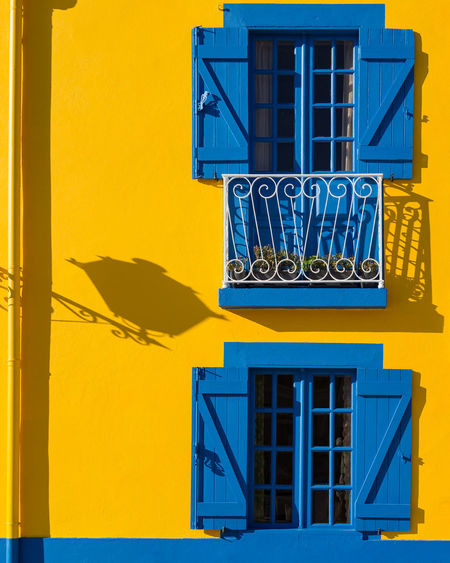 Portuguese architecture Architecture Blue Building Exterior Built Structure Day No People Outdoors Shadows Window Yellow