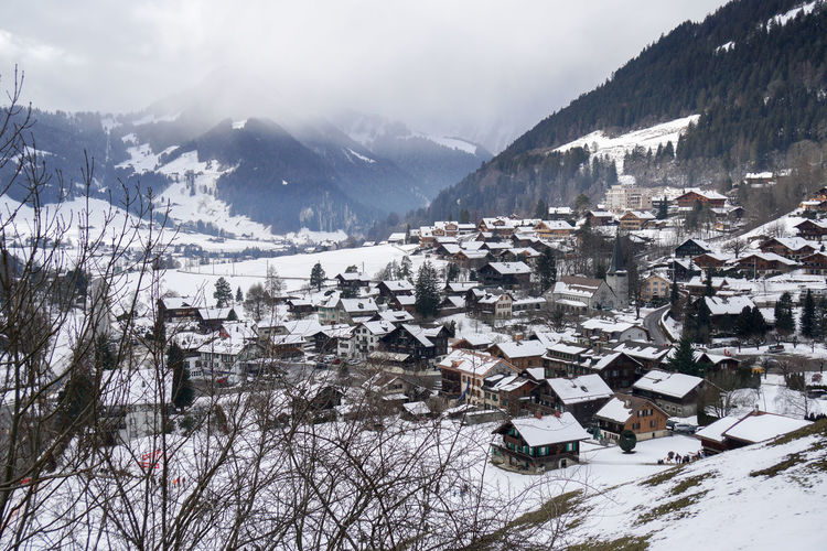 Snow covered houses and buildings in city