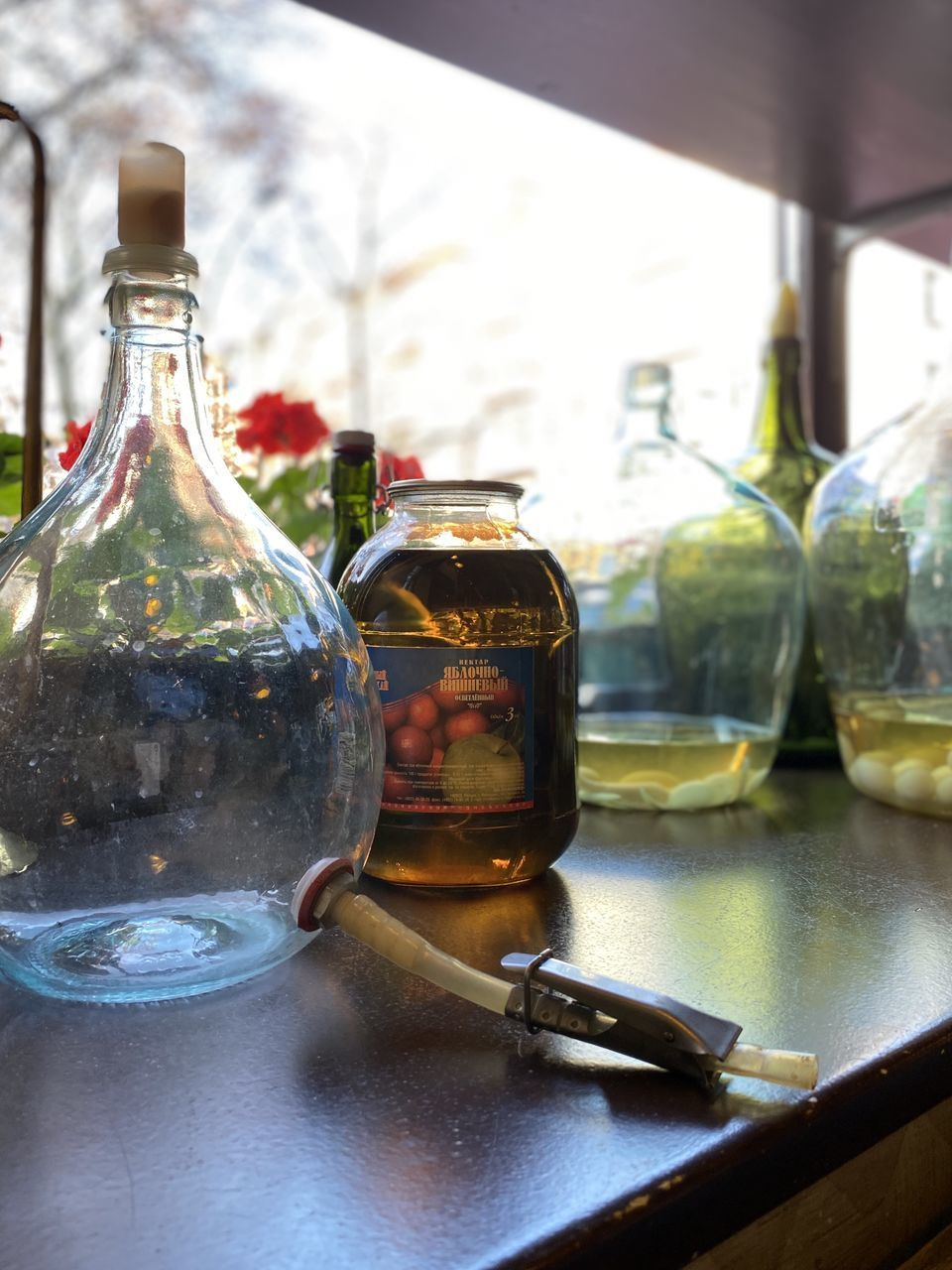 glass - material, table, container, transparent, food and drink, bottle, focus on foreground, still life, day, no people, indoors, close-up, drink, refreshment, freshness, jar, oil, food, reflection, olive oil, glass