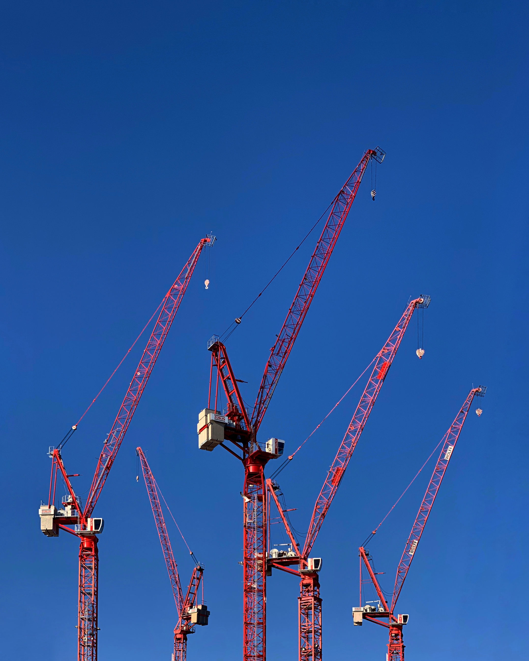 machinery, crane - construction machinery, blue, construction industry, sky, industry, construction site, clear sky, development, no people, day, nature, low angle view, metal, tall - high, copy space, outdoors, construction equipment, construction machinery, sunlight, industrial equipment