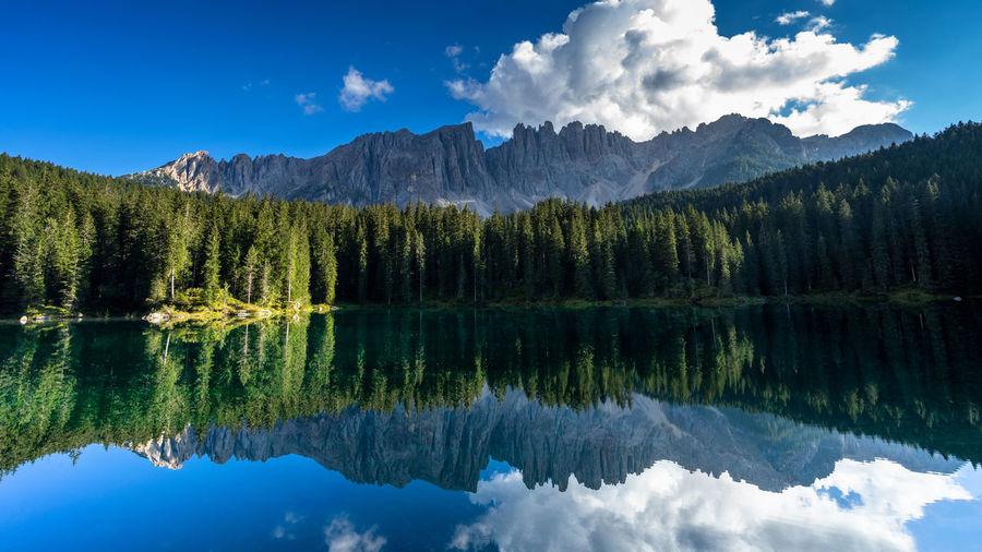 Carezza lake, mount latemar, bolzano province, south tyrol, italy. landscape of lake carezza
