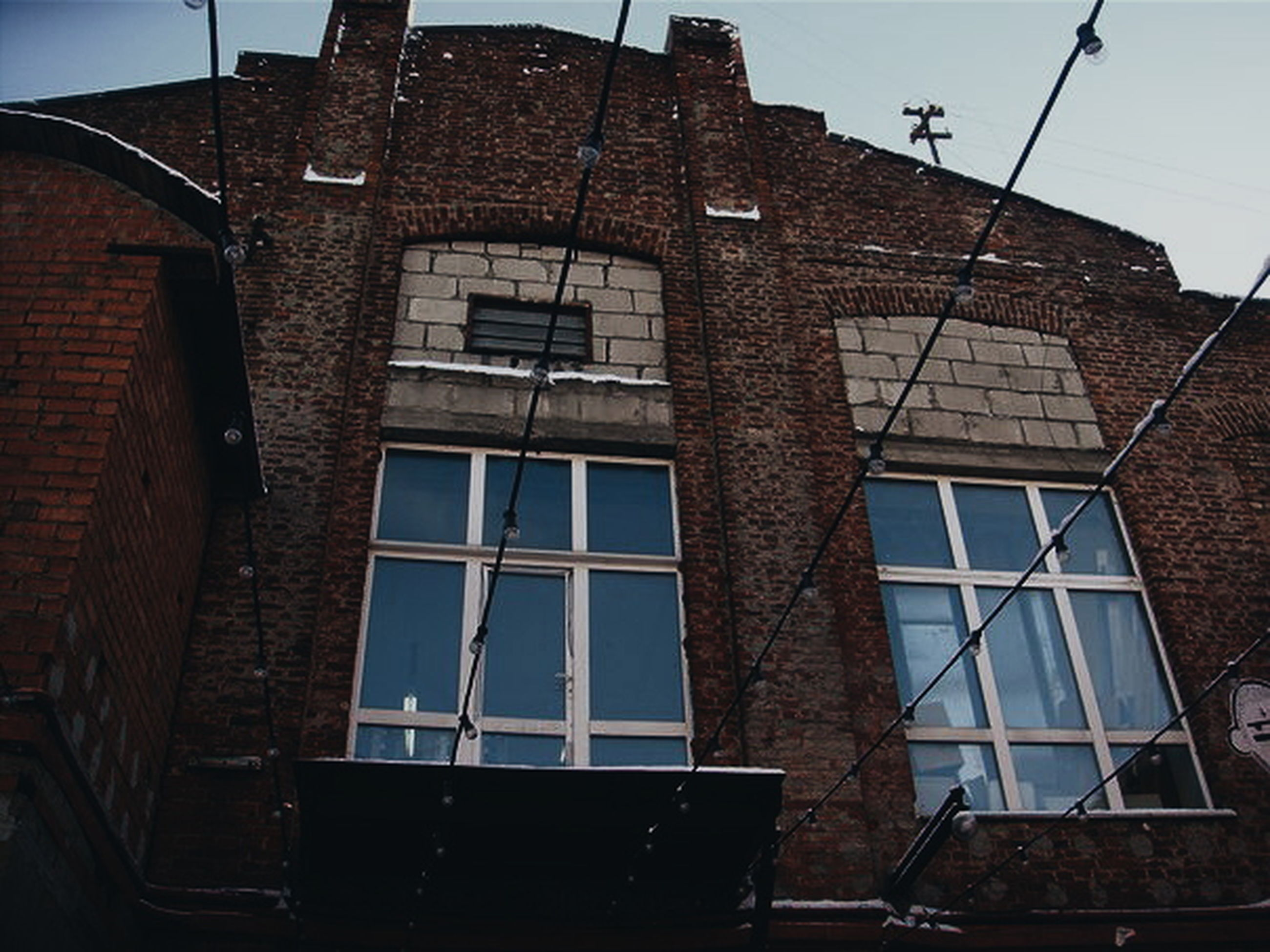 architecture, building exterior, built structure, low angle view, window, no people, clear sky, city, day, outdoors, sky