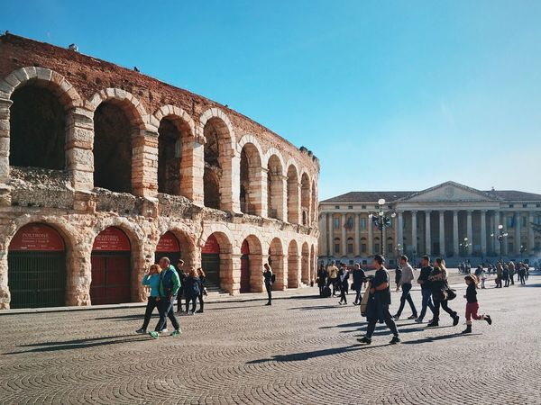 Roman amphitheatre. Architecture Building Exterior Real People Built Structure History Sunlight Lifestyles Clear Sky Travel Destinations Arch City Tourism Large Group Of People Day Leisure Activity Outdoors Sky Shootermag Mobilephotography Mobile Photography Youmobile NEM Street