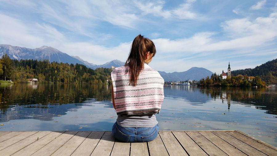 EyeEm Selects Only Women Reflection One Woman Only Adults Only One Person Water Adult Mountain Lake People Rear View Women Tranquility Vacations Young Adult Nature Outdoors Slovenia Bled Casual Clothing One Young Woman Only Mountain Range Young Women Day