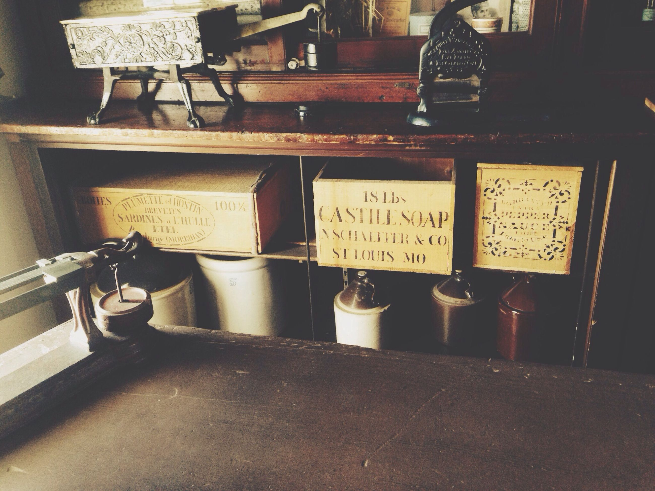 indoors, still life, table, old-fashioned, communication, metal, technology, old, retro styled, antique, close-up, no people, equipment, text, telephone, home interior, day, wood - material, western script, wall - building feature