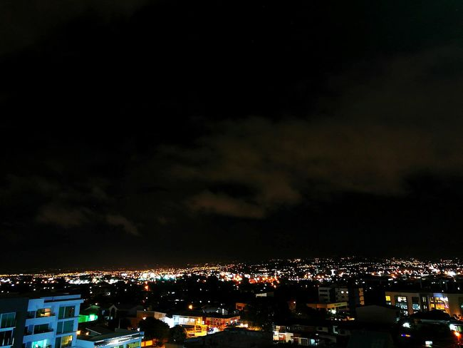 Sé cuando debo ceder y no es hoy. City Night Illuminated Costa Rica❤ TOWNSCAPE Lightning Rooftop Storm Cloud Storm Cumulonimbus Dramatic Sky Power In Nature Residential District Office Building Sky Only Town Settlement HUAWEI Photo Award: After Dark