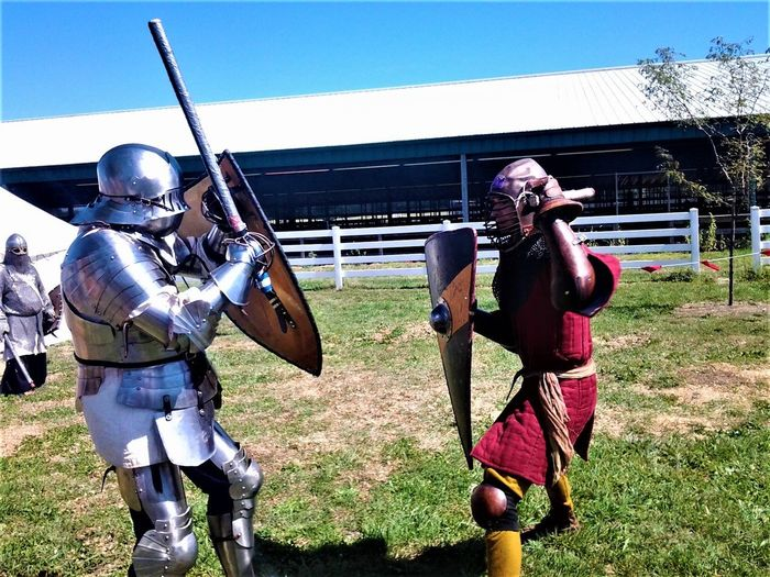 Medieval Knights at the Columbus Scottish Festival Day Nature Land Protection Field Weapon Shield Helmet Sky Conflict People Security Real People Outdoors Fighting Military Architecture Suit Of Armor Sword Grass Aggression  Knights Warriors Reenactment History