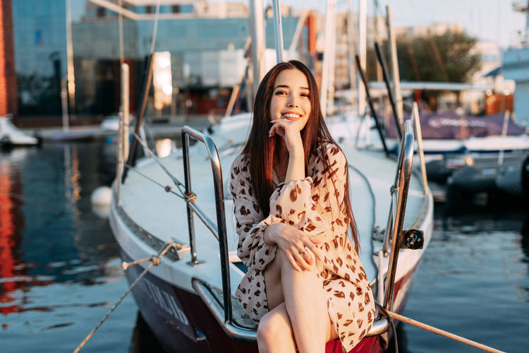 Young woman in boat on shore