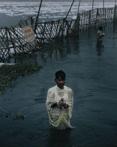 Man sitting in water