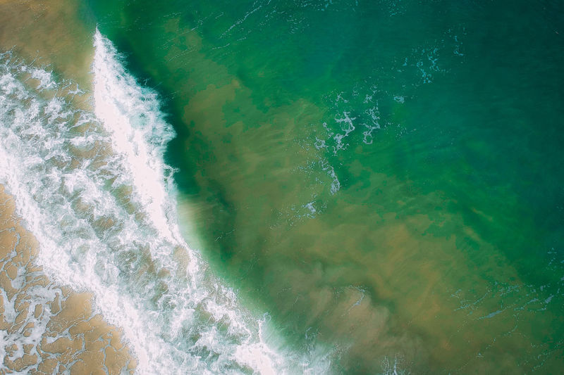 Water Sea Motion Wave Sport Beauty In Nature Aquatic Sport No People Nature Day Power Outdoors Beach Power In Nature Land Scenics - Nature High Angle View Close-up Turquoise Colored Breaking