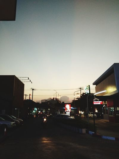 Sunset Illuminated Car Stoplight City Life Sky Architecture Built Structure Building Exterior Red Light Road Signal