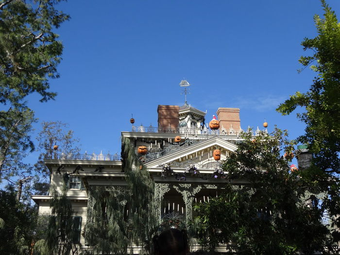 Low angle view of buildings against blue sky