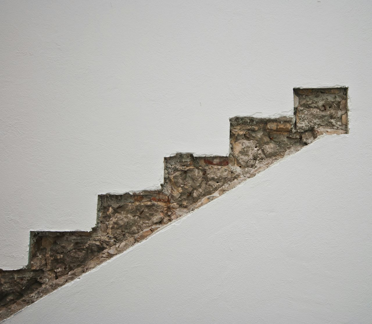 Steps by wall in building