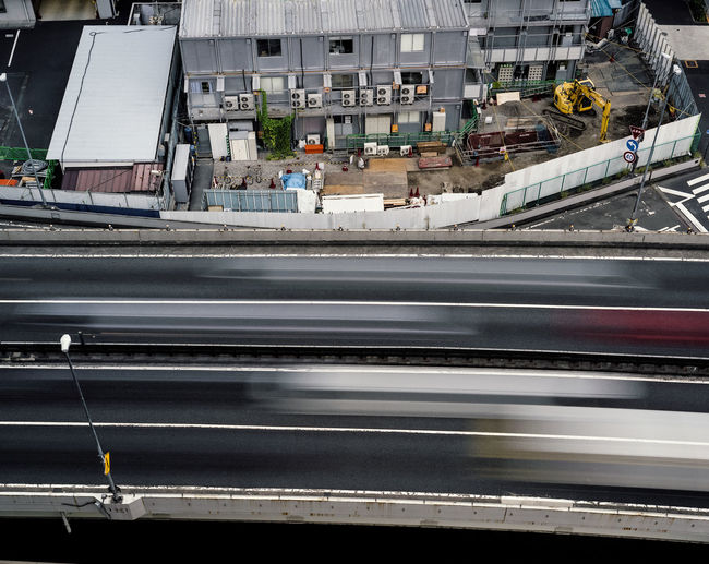 High angle view of railroad tracks by street in city