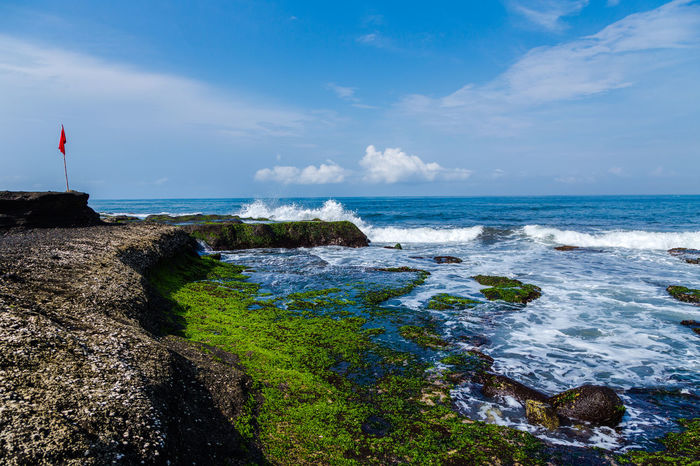 Beauty In Nature Blue Day Flag Horizon Over Water Motion Nature No People Outdoors Rock - Object Scenics Sea Sky Tanah Lot Water Wave
