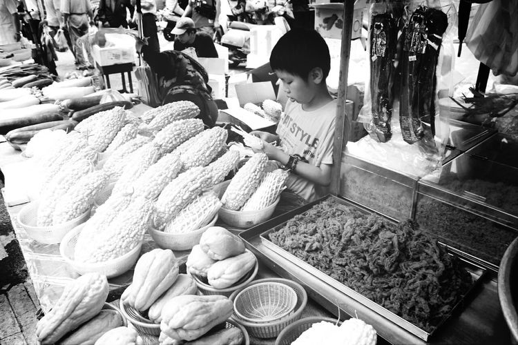 High Angle View Of Boy At Market Stall