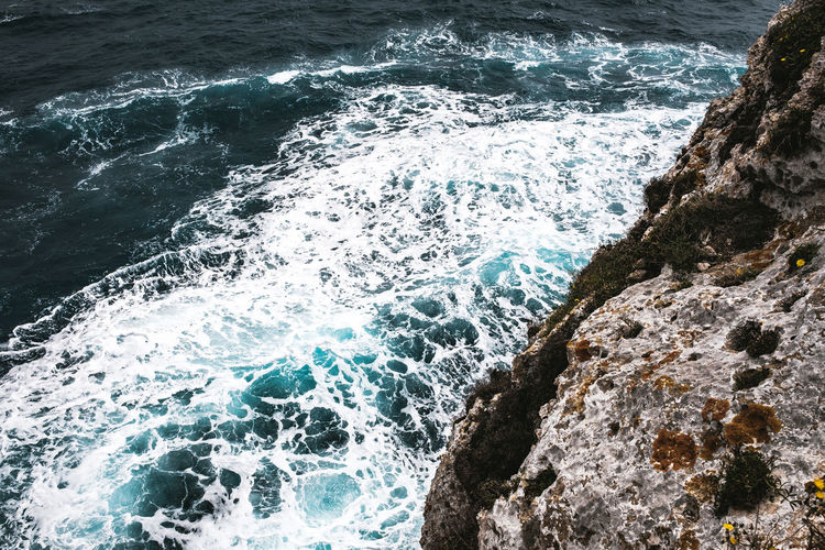 Sea Water Motion Wave Sport Rock Aquatic Sport Rock - Object Beauty In Nature Solid Surfing Nature Splashing Day Power In Nature High Angle View Land Outdoors Breaking Hitting Rocky Coastline Spray Rough Sea Rough Waters Turquoise Water