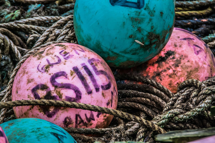 Buoys Circle Close-up Detail Dirty Fishing Gear Floats Large Group Of Objects Pink Rope Spiral Tangled Turquoise Pastel Pastel Power Fine Art Photography