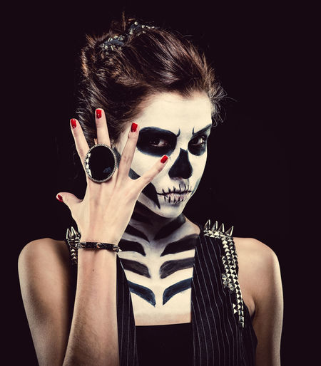 Woman with skeleton face art Black Background Day Of The Dead Halloween Horror Looking At Camera Make-up Makeup Skeleton Woman Body Arts Concept Conceptual Face Art One Person People Ring Skull Studio Shot Young Adult