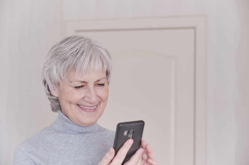 Portrait of woman holding mobile phone